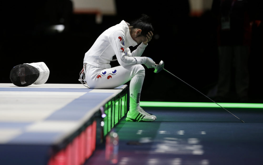 South Korea's Shin A-lam waits for an appeal to an officials' decision after a women's individual epee fencing semifinals match against Germany's Britta Heidemann at the 2012 Summer Olympics, Monday, July 30, 2012, in London. (AP Photo/Andrew Medichini)