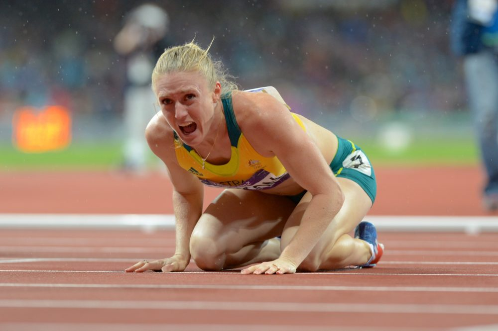 Australia's Sally Pearson reacts after winning the gold medal in the women's 100m hurdles at the athletics at the Olympic Stadium during the Olympic Games in London, Aug. 7, 2012. (AAP Image/Dean Lewins) NO ARCHIVING