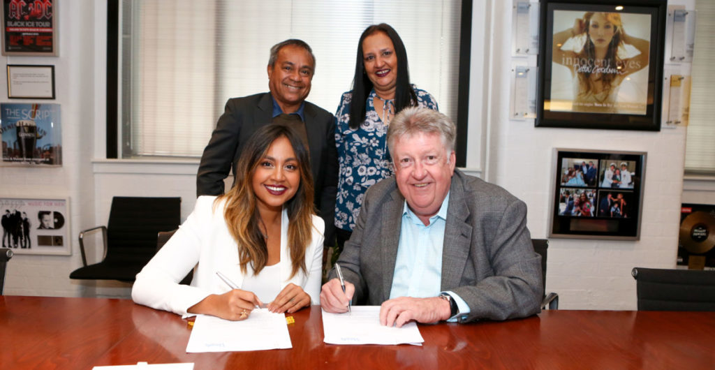 Jessica Mauboy signing her Parade Management contract with Denis Handlin, joined by her parents Therese and Ferdy Mauboy