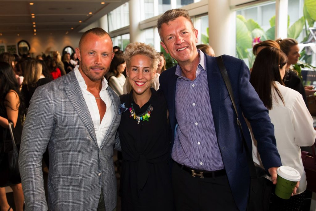Kylie Rogers (C) with Foxtel's Damien Cleary (L) and Andrew Mulready (R)